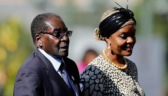 津巴布韦总统穆加贝和第一夫人格雷丝·穆加贝.图片来源:视觉中国