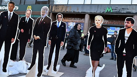 乌克兰大选启幕:一场现总统、前总理和演员的较量