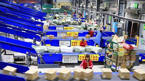 """国家邮政局:""""双11""""当天全国处理5.35亿快件,全行业临聘40万人"""