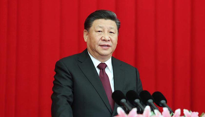 坚持以人民为中心用中国理论解读好中国实