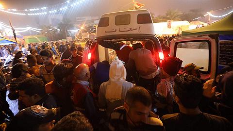 伊拉克首都示威人群遭不明身份枪手袭击,16死47伤